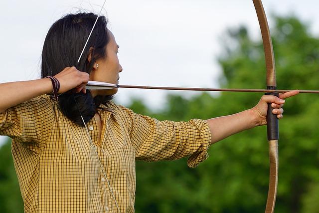 lady pushing archery